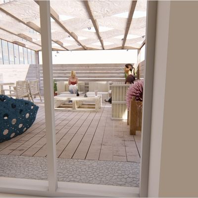 terrazza con zona barbecue e zona relax