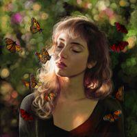 A girl among the butterflies
